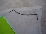 """Make a back neck facing by tracing the back neckline edge.  Trace 1"""" along the shoulder seam and the CB line."""