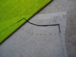 "Then use a ruler to mark a series of dots 1"" from the neckline edge."