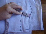 "Then I follow the line of the neckline around with my tape measure, marking a dash every so often at 2"" (5cm)."