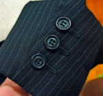 Nice buttonholes, worked through all layers and uncut with buttons sewn over the top.