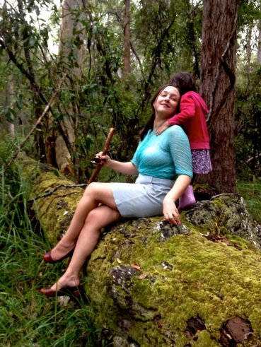 Lila photobomb on the mossy log...
